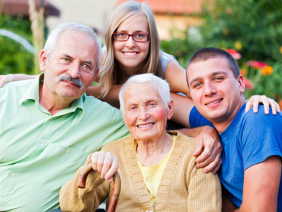 Elderly with family and caregiver