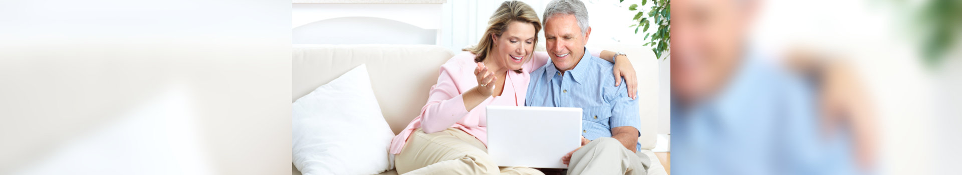 smiling old couple using laptop