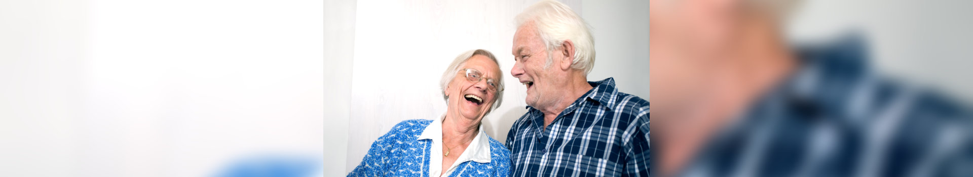 old couple happily talking