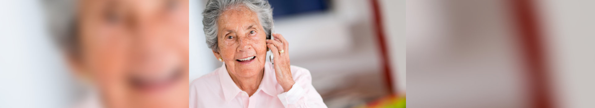 old woman calling someon using her mobile phone